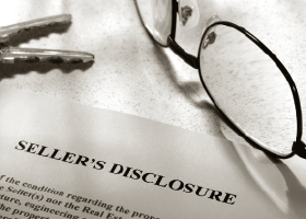document titled Seller's Disclosure with a pair of eyeglasses and keys laying around